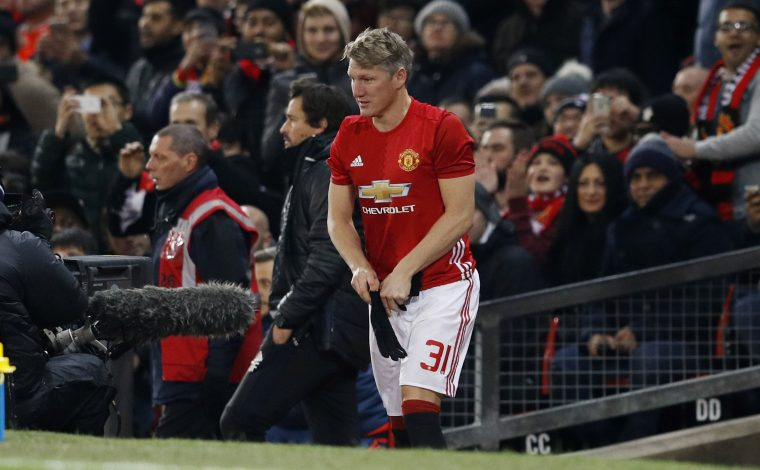 Bastian Schweinsteiger prepares to come on as a substitute.