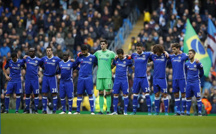 Chelsea players observe a minutes silence
