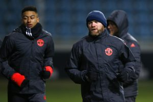 Manchester United's Jesse Lingard (L) and Wayne Rooney during training.