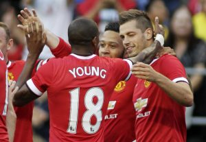Morgan Schneiderlin (R) celebrates scoring a goal with Ashley Young (L) and Memphis Depay (C).