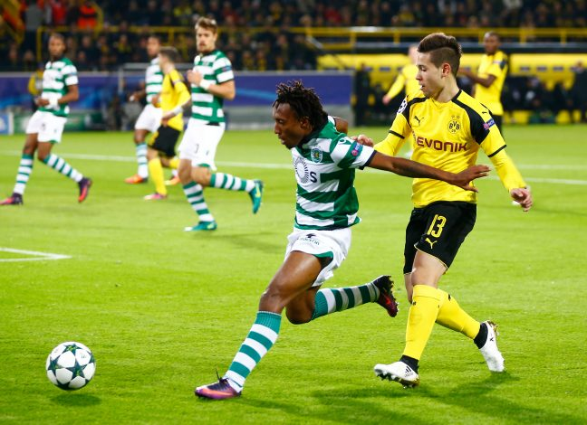 Football Soccer - Borussia Dortmund v Sporting Lisbon - Champions League - Group F - Signal Iduna Park, Dortmund, Germany - 02/11/16. Borussia Dortmund's Raphael Guerreiro in action with Sporting Lisbon's Gelson Martins. REUTERS/Wolfgang Rattay - RTX2RLB0