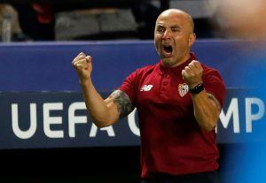 Sevilla's coach Jorge Sampaoli celebrates a goal against Dinamo Zagreb.