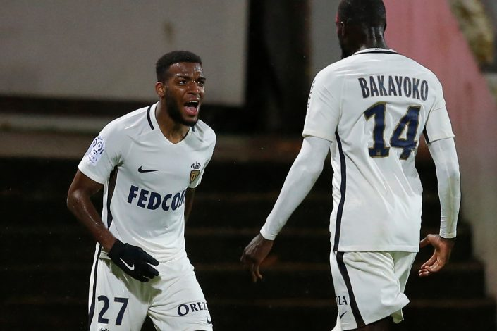 Thomas Lemar celebrates with his team mate Tiemoue Bakayoko.
