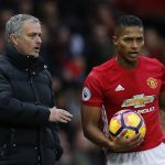 Jose Mourinho speaks with Antonio Valencia.