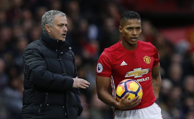 Jose Mourinho speaks with Antonio Valencia.