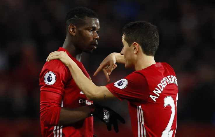 Paul Pogba speaks with Ander Herrera.