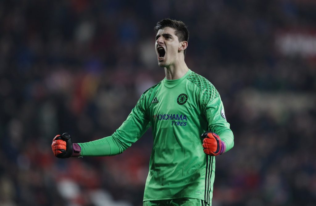 Thibaut Courtois celebrates after the game.