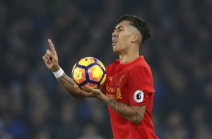 Roberto Firmino appeals to referee Mike Dean after fouling Aaron Lennon.