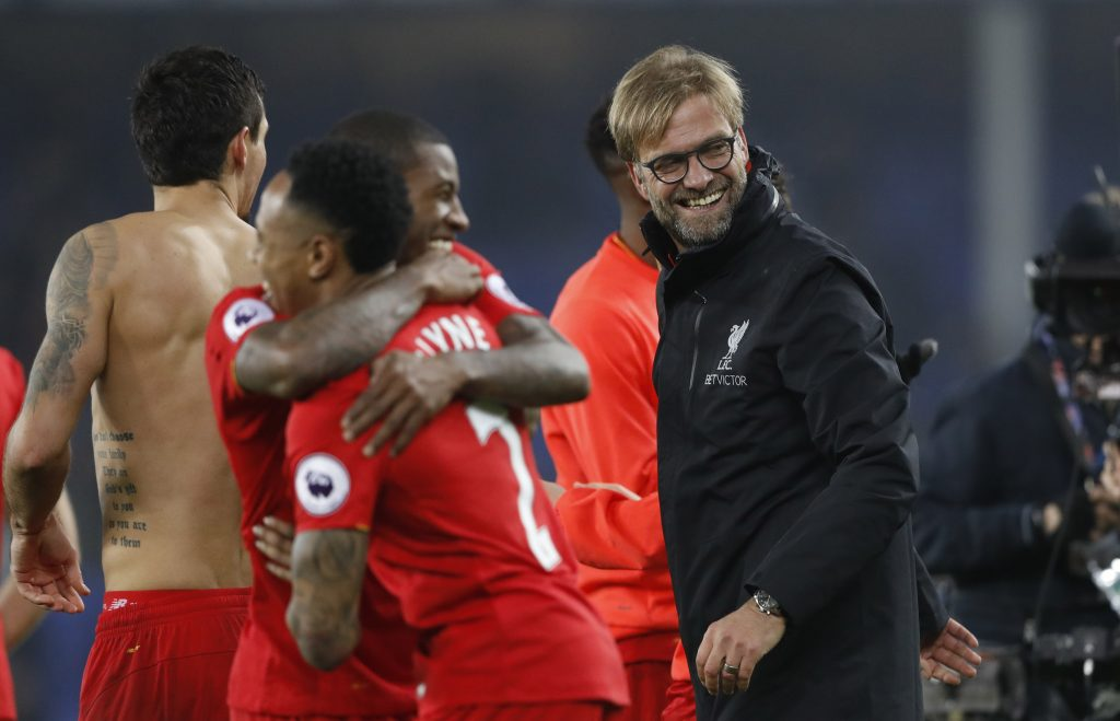Jurgen Klopp celebrates after the match with players.
