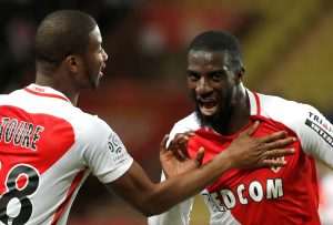 Tiemoue Bakayoko (R) celebrates with teammate Almamy Toure after scoring.