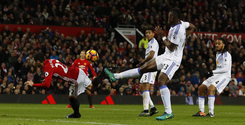 Henrikh Mkhitaryan scores United's third goal.