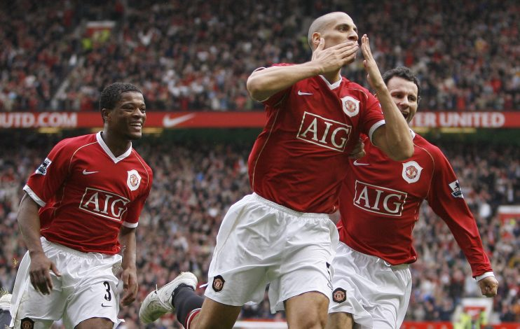 Manchester United's Rio Ferdinand celebrates with team mates Patrice Evra (L) and Ryan Giggs (R).