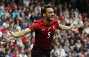 Hakan Calhanoglu celebrates after scoring the first goal for Turkey.