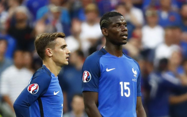 France's Antoine Griezmann and Paul Pogba.