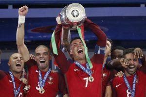 Portugal's Cristiano Ronaldo celebrates with Pepe, Ricardo Quaresma and Joao Moutinho and the trophy after winning Euro 2016.