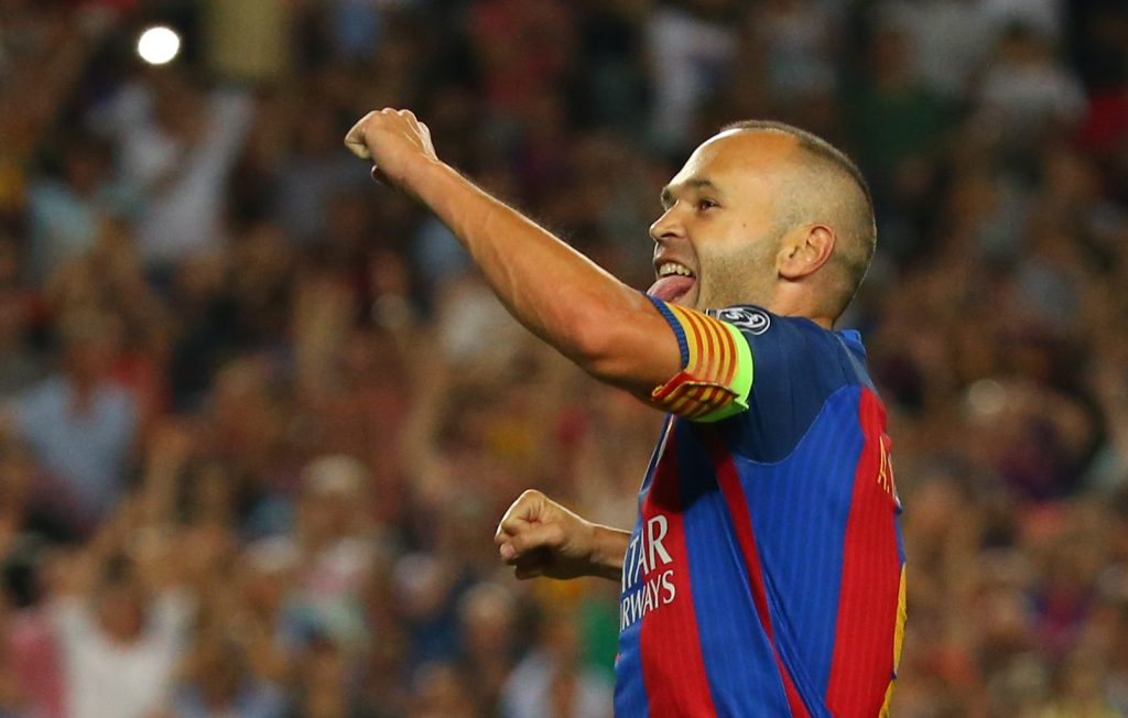 Barcelona's Andres Iniesta celebrates scoring their fourth goal.