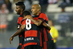 Flamengo's Rodinei (L), Marcio Araujo (8) and Emerson Sheik (R) celebrate Sheik's goal against Palestino.