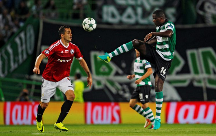 Sporting's William Carvalho in action with Legia's Tomasz Jodlowiec.