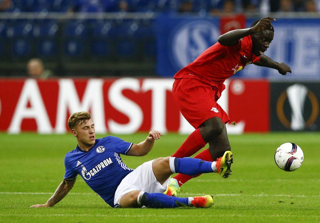 Schalke's Max Meyer and Salzburg's Dayot Upamecano in action.