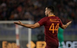 Kostas Manolas celebrates after scoring against Inter Milan.