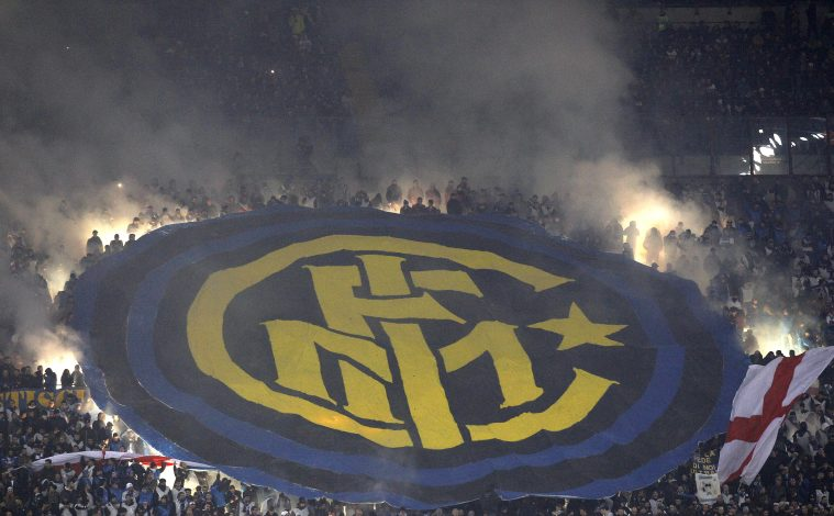 Inter Milan's supporters hold up a giant banner during the match.