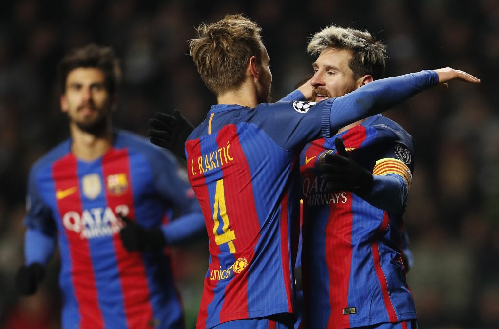 Barcelona's Luis Suarez celebrates scoring their second goal with Ivan Rakitic.