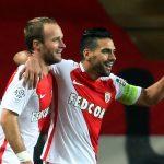 Monaco's Valere Germain (L) reacts after scoring next to teammate Radamel Falcao.