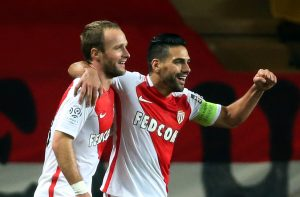 Monaco's Valere Germain (L) reacts after scoring next to teammate Radamel Falcao.