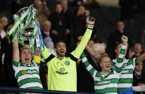 Celtic's Scott Brown, Craig Gordon and Leigh Grifiths celebrate winning the final with the trophy.