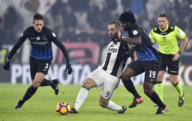 Gonzalo Higuain in action with Atalanta's Rafael Toloi and Franck Kessie