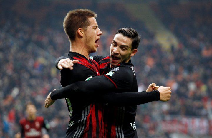 AC Milan's Mario Pasalic celebrates with his team mate Mattia De Sciglio after scoring.