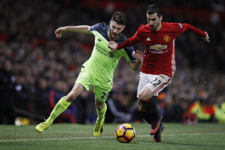 Adam Lallana in action with Henrikh Mkhitaryan.
