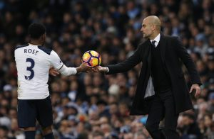 Manchester City manager Pep Guardiola and Tottenham's Danny Rose.