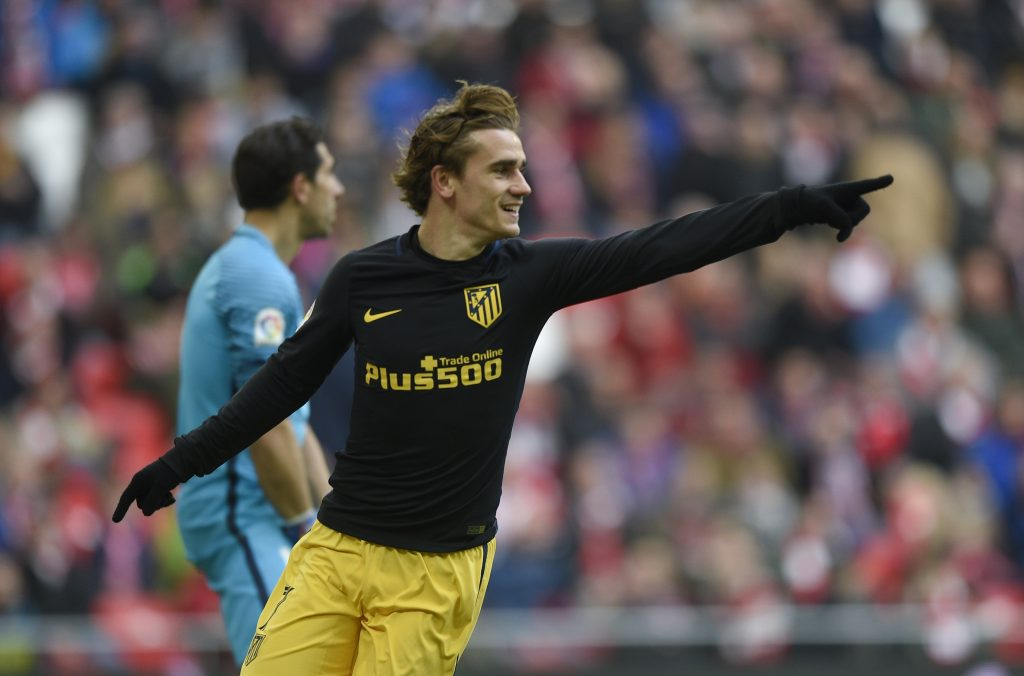Atletico Madrid's Antoine Griezmann celebrates his team's first goal.