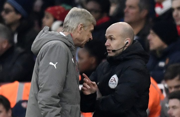 Arsenal manager Arsene Wenger clashes with fourth official Anthony Taylor.