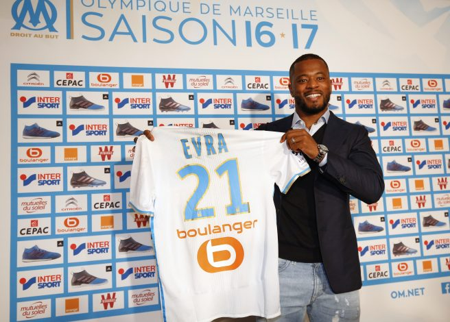Olympique Marseille's latest recruit Patrice Evra displays his new jersey.c