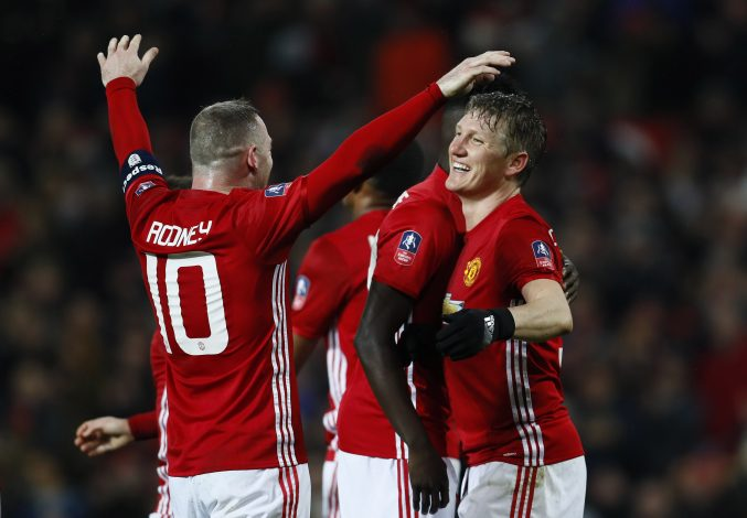 Manchester United's Bastian Schweinsteiger celebrates scoring their fourth goal with Wayne Rooney.