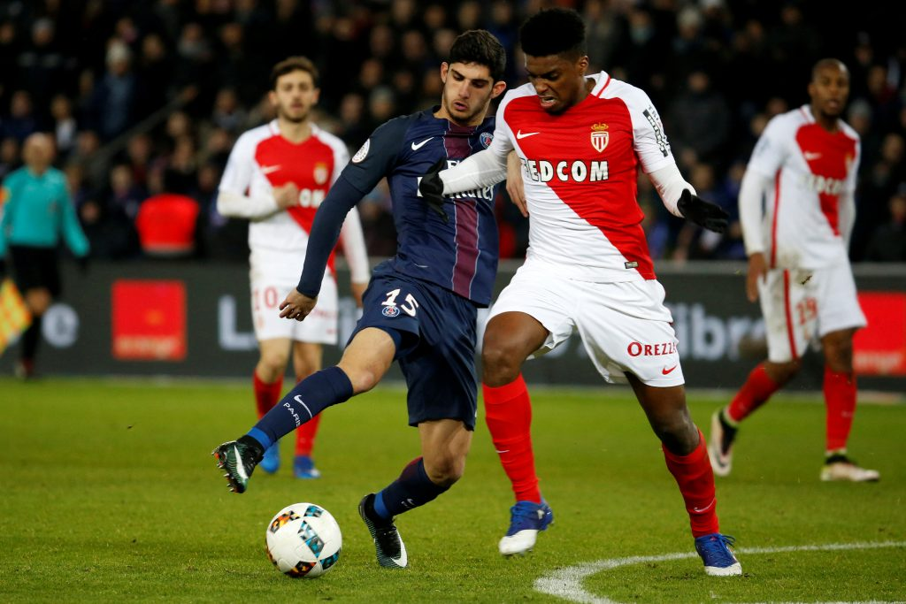 AS Monaco's Nascimento challenges Paris Saint Germain's Goncalo Guedes.