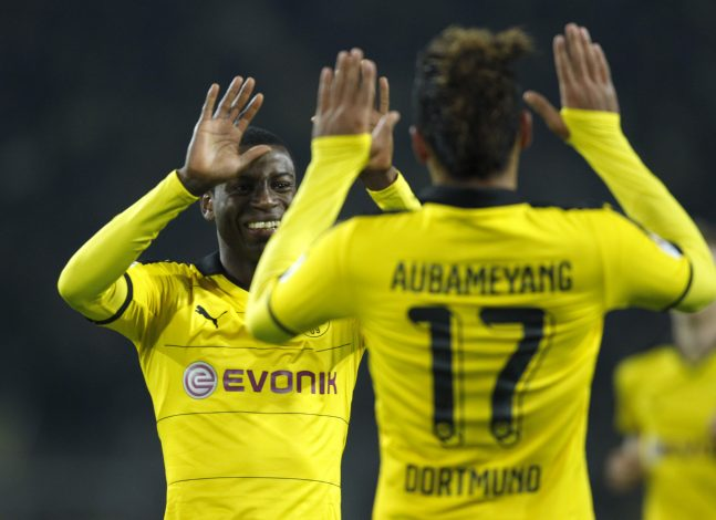 Borussia Dortmund's Pierre-Emerick Aubameyang celebrates the fourth goal against VfB Stuttgart with Adrian Ramos.