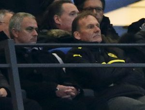 Jose Mourinho (L) and Hans-Joachim Watzke, Borussia CEO watch the match.