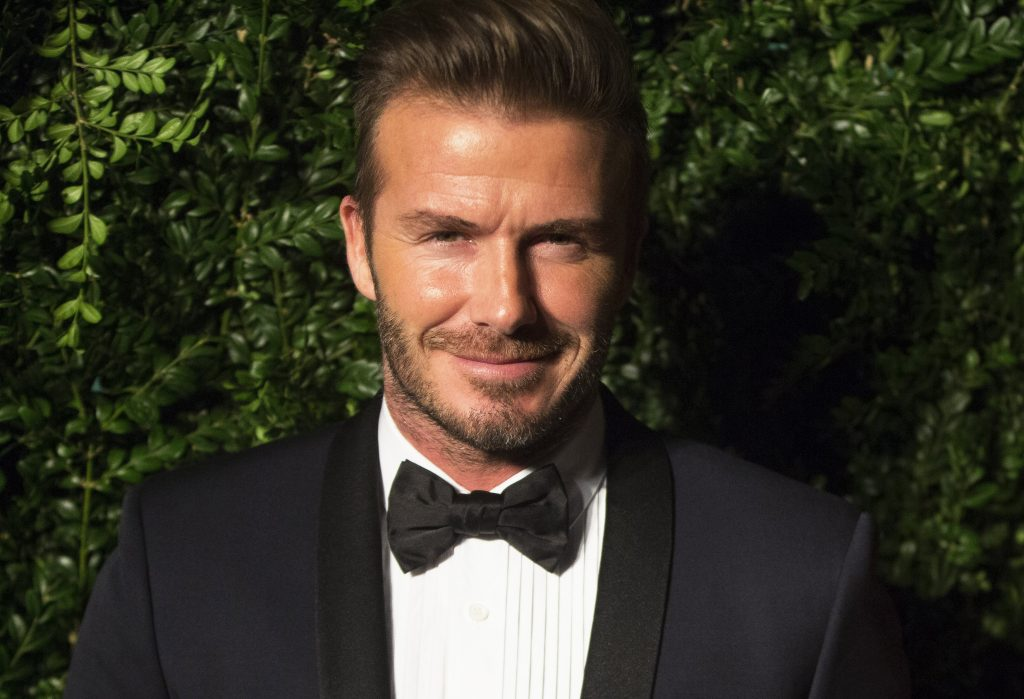 David Beckham smiles at the Evening Standard Theatre awards in London.