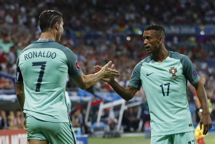Portugal's Cristiano Ronaldo celebrates with Nani.