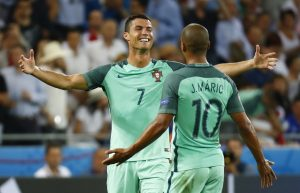 Portugal's Cristiano Ronaldo celebrates with Joao Mario at the end of the match.