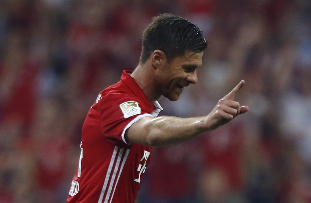 Football Soccer - Bayern Munich v Werder Bremen - German Bundesliga - Allianz Arena, Munich, Germany - 26/08/16 - Bayern Munich's Xabi Alonso celebrates after scoring the first goal against Werder Bremen    REUTERS/Michaela Rehle DFL RULES TO LIMIT THE ONLINE USAGE DURING MATCH TIME TO 15 PICTURES PER GAME. IMAGE SEQUENCES TO SIMULATE VIDEO IS NOT ALLOWED AT ANY TIME. FOR FURTHER QUERIES PLEASE CONTACT DFL DIRECTLY AT + 49 69 650050.   - RTX2N7NW