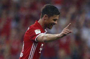 Bayern Munich's Xabi Alonso celebrates after scoring the first goal against Werder Bremen.