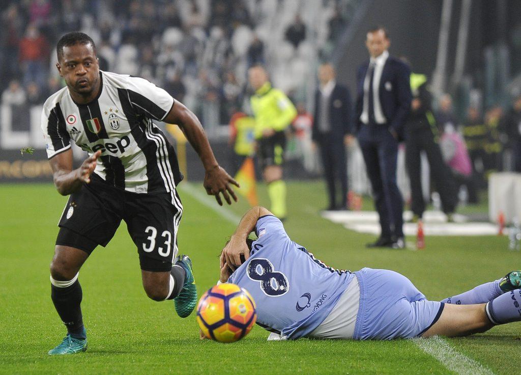 Patrice Evra in action against Sampdoria' Davide Biondini.