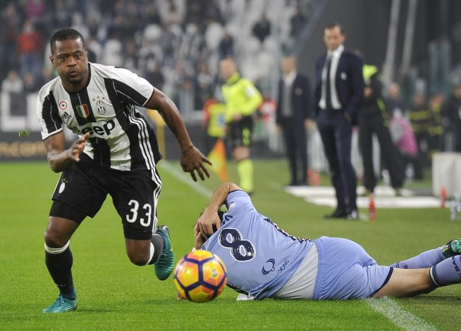 Patrice Evra in action against Sampdoria' Davide Biondini.