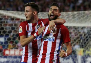 Yannick Carrasco (R) celebrates after scoring his second goal with team mate Saul Niguez.
