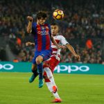 Barcelona's Sergi Roberto and Granada's Andreas Pereira in action .