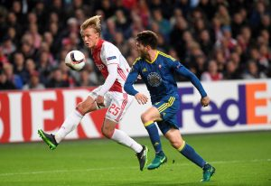 Ajax Amsterdam's Kasper Dolberg and Celta de Vigo's Carles Planas in action.